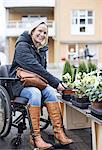 Portrait of disabled woman in wheelchair choosing plants at nursery Stock Photo - Premium Royalty-Free, Artist: CulturaRM, Code: 698-06616015