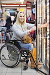Portrait of happy disabled woman in wheelchair at refrigerated section of supermarket Stock Photo - Premium Royalty-Free, Artist: Aflo Relax, Code: 698-06616020