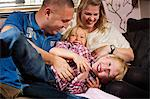 Portrait of mischievous children playing with parents at home Stock Photo - Premium Royalty-Free, Artist: Cultura RM, Code: 698-06616029