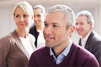 Business people looking away at office Stock Photo - Premium Royalty-Freenull, Code: 698-06616062