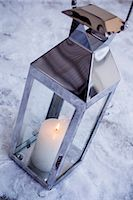 Candle lantern on snow Stock Photo - Premium Royalty-Freenull, Code: 698-06616116
