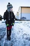 Disabled boy with crutches looking away in winter Stock Photo - Premium Royalty-Free, Artist: Kablonk! RM, Code: 698-06616120