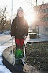 Portrait of disabled boy in warm clothing standing with crutches Stock Photo - Premium Royalty-Free, Artist: Cultura RM, Code: 698-06616128