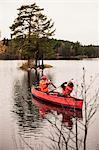 Siblings canoeing on river Stock Photo - Premium Royalty-Freenull, Code: 698-06616134