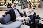 Portrait of senior couple with shopping bags sitting on sofa at mall Stock Photo - Premium Royalty-Freenull, Code: 698-06616185