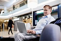 people on mall - Senior man on sofa using laptop at shopping mall Stock Photo - Premium Royalty-Freenull, Code: 698-06616192