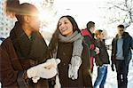 Happy young women in warm clothing with male friends in background Stock Photo - Premium Royalty-Free, Artist: ableimages, Code: 698-06616269