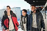 Happy multi ethnic friends walking on platform Stock Photo - Premium Royalty-Free, Artist: Blend Images, Code: 698-06616273