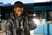 African American young man checking time at railway station Stock Photo - Premium Royalty-Freenull, Code: 698-06616284