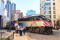 Metra Train passing pedestrians at an open railroad crossing, Downtown, Chicago, Illinois, United States of America, North America Stock Photo - Premium Rights-Managednull, Code: 841-06616700