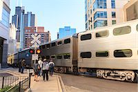 Metra Train passing pedestrians at an open railroad crossing, Downtown, Chicago, Illinois, United States of America, North America Stock Photo - Premium Rights-Managednull, Code: 841-06616701