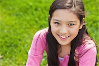 preteen asian girls - Girl Relaxing On the Grass Stock Photo - Premium Rights-Managednull, Code: 859-06617453