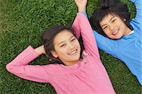 preteen girls stretching - Girl And Boy Relaxing On the Grass Stock Photo - Premium Rights-Managednull, Code: 859-06617455