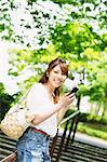 Woman Checking Smartphone Stock Photo - Premium Rights-Managed, Artist: Aflo Relax, Code: 859-06617465