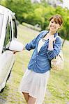 Woman Smiling With Car Stock Photo - Premium Rights-Managed, Artist: Aflo Relax, Code: 859-06617474