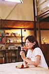 Woman Having a Meal at a Cafe Stock Photo - Premium Rights-Managed, Artist: Aflo Relax, Code: 859-06617486