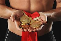 Man Holding Medals Stock Photo - Premium Rights-Managednull, Code: 858-06617651