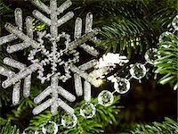 snowflakes  holiday - Beaded snowflake decoration close up Stock Photo - Premium Royalty-Freenull, Code: 618-06618212