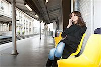 platform - Woman on cell phone at train station Stock Photo - Premium Royalty-Freenull, Code: 649-06621971