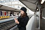 Woman using tablet computer on platform Stock Photo - Premium Royalty-Free, Artist: Robert Harding Images, Code: 649-06621973