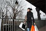 Woman carrying shopping bags outdoors Stock Photo - Premium Royalty-Free, Artist: Westend61, Code: 649-06621975