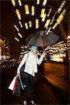 Woman under umbrella on city street Stock Photo - Premium Royalty-Free, Artist: CulturaRM, Code: 649-06622014