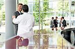 Businessman and doctor shaking hands Stock Photo - Premium Royalty-Free, Artist: Blend Images, Code: 649-06622069