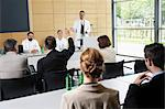 Doctors giving talk in conference room Stock Photo - Premium Royalty-Free, Artist: Blend Images, Code: 649-06622074
