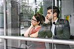 Couple looking out window Stock Photo - Premium Royalty-Free, Artist: Westend61, Code: 649-06622113