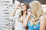 Women trying on glasses in store Stock Photo - Premium Royalty-Free, Artist: Blend Images, Code: 649-06622201