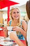 Women having coffee at sidewalk cafe Stock Photo - Premium Royalty-Free, Artist: Robert Harding Images, Code: 649-06622215