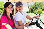 Women driving golf cart on course Stock Photo - Premium Royalty-Free, Artist: Blend Images, Code: 649-06622221