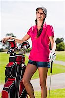 Woman holding golf bag on course Stock Photo - Premium Royalty-Freenull, Code: 649-06622229
