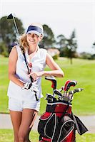 Woman with golf bag on course Stock Photo - Premium Royalty-Freenull, Code: 649-06622230