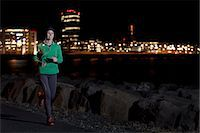 Woman running on waterfront at night Stock Photo - Premium Royalty-Freenull, Code: 649-06622244