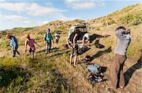 Hikers putting on safety equipment Stock Photo - Premium Royalty-Freenull, Code: 649-06622363