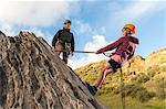 People abseiling in rock climbing lesson Stock Photo - Premium Royalty-Free, Artist: Blend Images, Code: 649-06622365