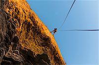 rock climber - Rock climber scaling steep rock face Stock Photo - Premium Royalty-Freenull, Code: 649-06622366