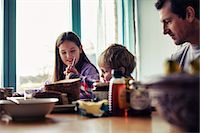 Family eating together at table Stock Photo - Premium Royalty-Freenull, Code: 649-06622415