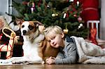 Boy and dog by Christmas tree Stock Photo - Premium Royalty-Free, Artist: Ty Milford, Code: 649-06622455