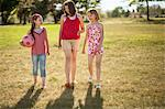 Girls walking together in field Stock Photo - Premium Royalty-Free, Artist: Blend Images, Code: 649-06622479