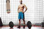 Man standing with weights in gym Stock Photo - Premium Royalty-Free, Artist: Blend Images, Code: 649-06622495
