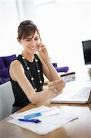 person on phone with credit card - Businesswoman shopping on phone Stock Photo - Premium Royalty-Freenull, Code: 649-06622521
