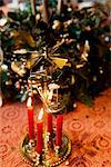 Candles burning on Christmas decoration Stock Photo - Premium Royalty-Free, Artist: Blend Images, Code: 649-06622617