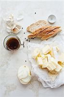 Sliced bread, butter and garlic Stock Photo - Premium Royalty-Freenull, Code: 649-06622639