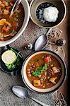 Bowl of stew with garlic and lemon Stock Photo - Premium Royalty-Free, Artist: Daryl Benson, Code: 649-06622642