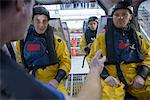 Oil workers in simulated helicopter Stock Photo - Premium Royalty-Free, Artist: Westend61, Code: 649-06622749