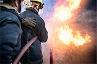 Firefighters in simulation training Stock Photo - Premium Royalty-Freenull, Code: 649-06622756