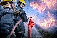 student fighting - Firefighters in simulation training Stock Photo - Premium Royalty-Freenull, Code: 649-06622757