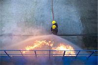 student fighting - Firefighters in simulation training Stock Photo - Premium Royalty-Freenull, Code: 649-06622759